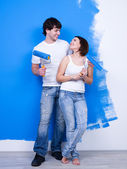 Cheerful flirting couple of painters — Stock Photo