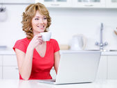Woman with cup of coffee and laptop — Stock Photo