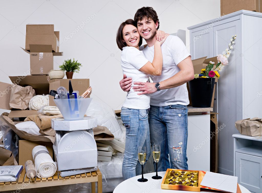 Happy beautiful couple embracing in their new flat — Stock Photo #3731712