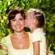 Portrait of  mother and daughter outdoors - Stock Photo