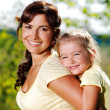 Royalty-Free Stock Photo: Portrait of  mother and daughter outdoors