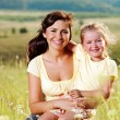 Stock Photo: Happy mother and little daughter on nature