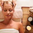 Attractive female getting recreation massage of head — Stock Photo #3784487
