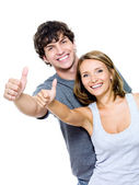 Smiling with thumbs-up gesture — Stock Photo