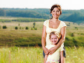 Happy mother and little daughter on nature — Stock Photo