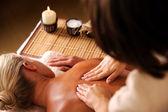 Massaging backbone of woman — Stock Photo