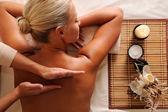 Female getting relaxation massage in beauty salon — Stockfoto