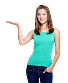 Woman showing something on palm — Stock Photo
