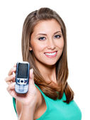 Woman showing mobile phone — Stock Photo