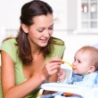 Mother feeding hungry baby — Stock Photo #3830350