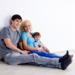 Family with son in empty room — Stock Photo