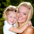 Smiling and beautiful mother and little daughter - Foto Stock