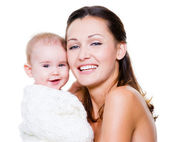 Happy mother with smiling baby — Stock Photo