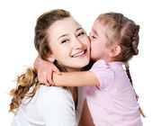 Daughter kissing her mother — Stock Photo
