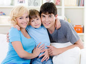Happy smiling family at home — Stock Photo