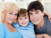 Happy smiling family with son — Stockfoto