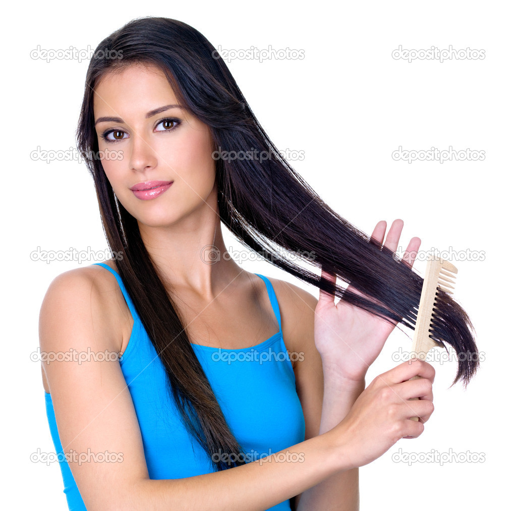 Young pretty brunette woman combing her beautiful long hair - isoalted on white background  Stock Photo #3830842