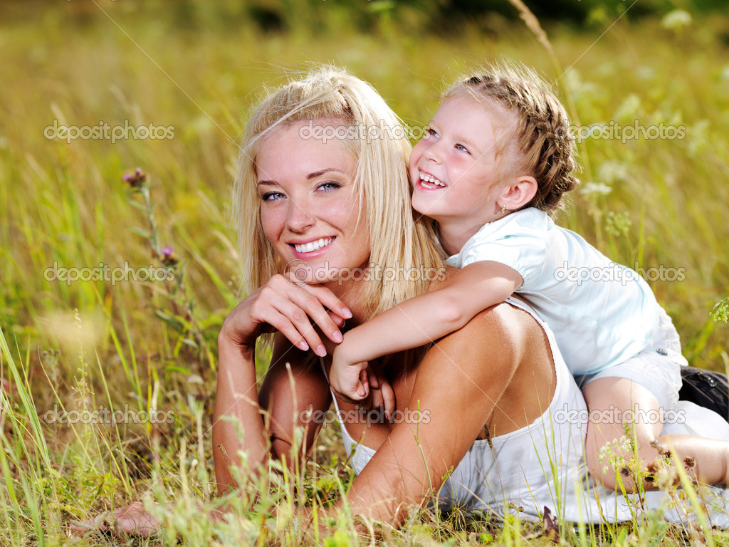 Happiness of the  mother and daughter - on nature  Stock Photo #3830999