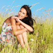 Young beautiful smiling woman outdoors - Stock Photo