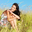 Stock Photo: Young beautiful smiling woman outdoors