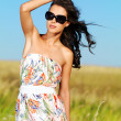 Stock Photo: Beautiful woman on nature in black sunglasses