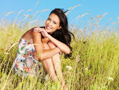 Young beautiful smiling woman outdoors — Stok fotoğraf