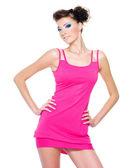 Beautiful glamour woman posing in pink dress — Stock Photo