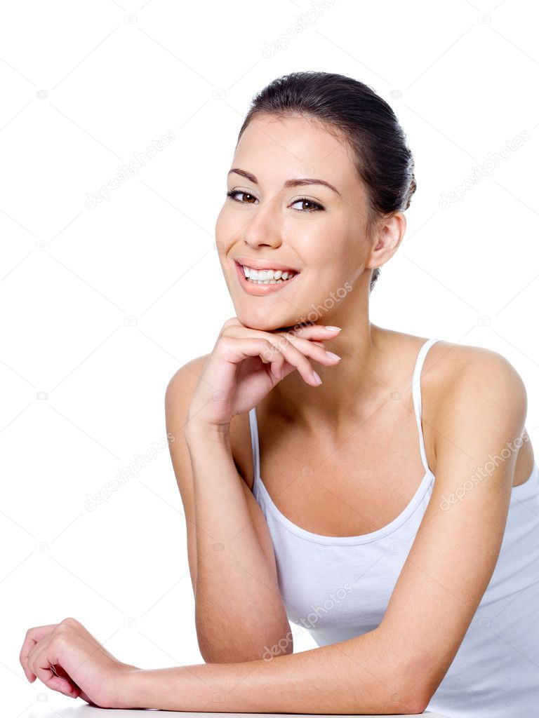 Happy young beautiful woman sitting with cheerful smile - isolated on white — Stock Photo #3840807