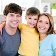 Happy smiling faces of young family — Stockfoto