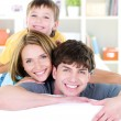 Happy smiling faces of young family — Stock Photo #3890448