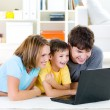 Royalty-Free Stock Photo: High-angle portait of family with laptop