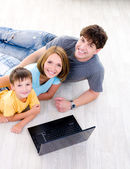 High-angle portait of family with laptop — Stock Photo