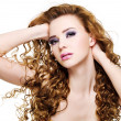 Beautiful woman with long curly hairs — Stock Photo
