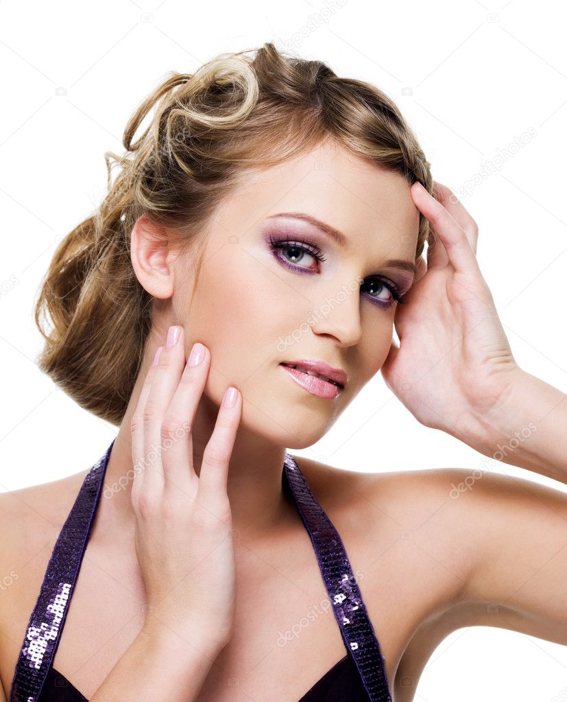 Beautiful blond woman with fashion purple eye-make-up with hands at face  Stock Photo #3907548