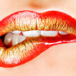 Golden makeup of female  lips - Stok fotoğraf