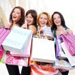 Happy smiling women with shopping bags — Stockfoto
