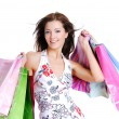 Portrait young adult girl with colored bags — Stock Photo #3913263