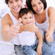 Happy family showing thumbs-up gesture — Stock Photo #3913321