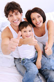 Happy family showing thumbs-up gesture — Stock Photo