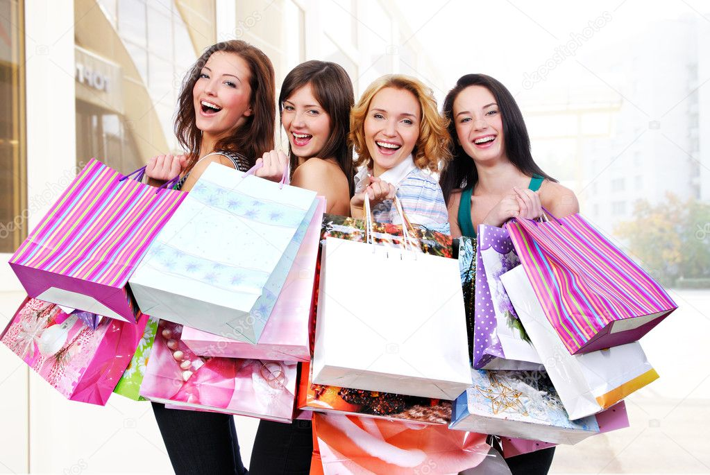 Group of happy smiling women with shopping  bags  — Stock Photo #3913260