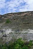 Sheer cliffs, ancient caves — Stock Photo