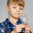 Boy and light bulb - Stock Photo