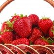 Strawberry in wicker basketbasket — Stock Photo