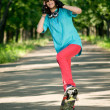 Royalty-Free Stock Photo: Teenage girl with skateboard