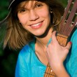 Stock Photo: Teenage girl with guitar