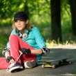 Teenage girl with skateboard — Stok fotoğraf