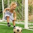 Girl with soccer ball - Stock Photo