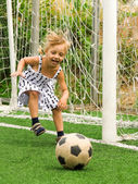 Girl with soccer ball — Stock Photo