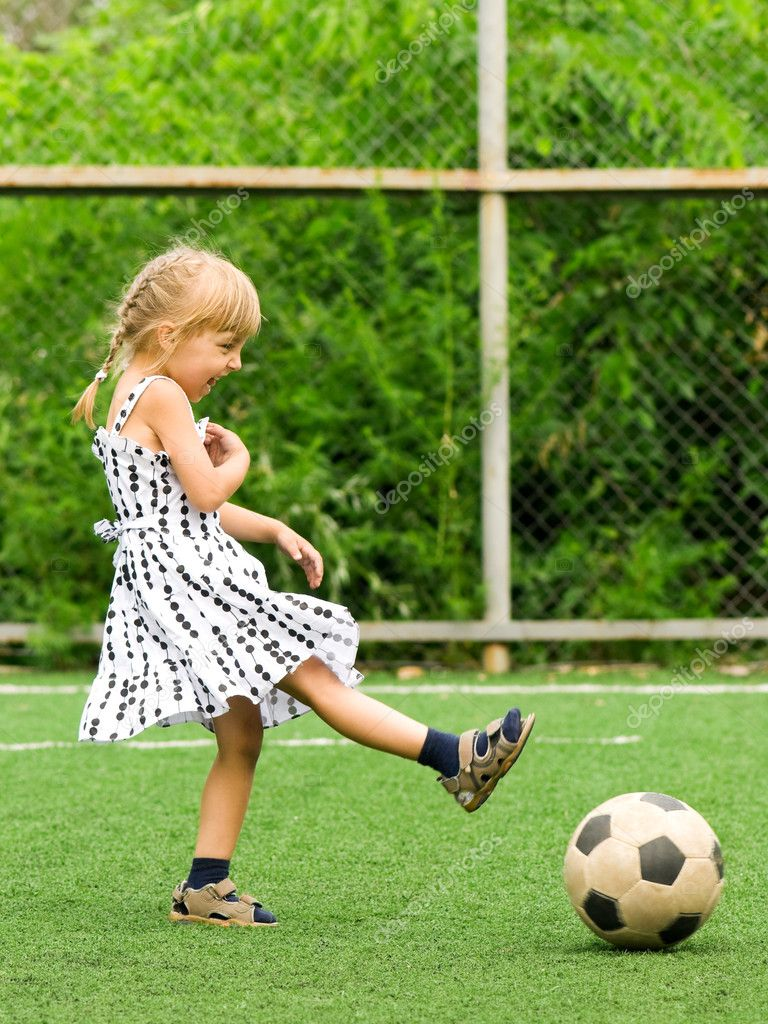 Funny young caucasian girl with soccer ball — Stock Photo #3578783