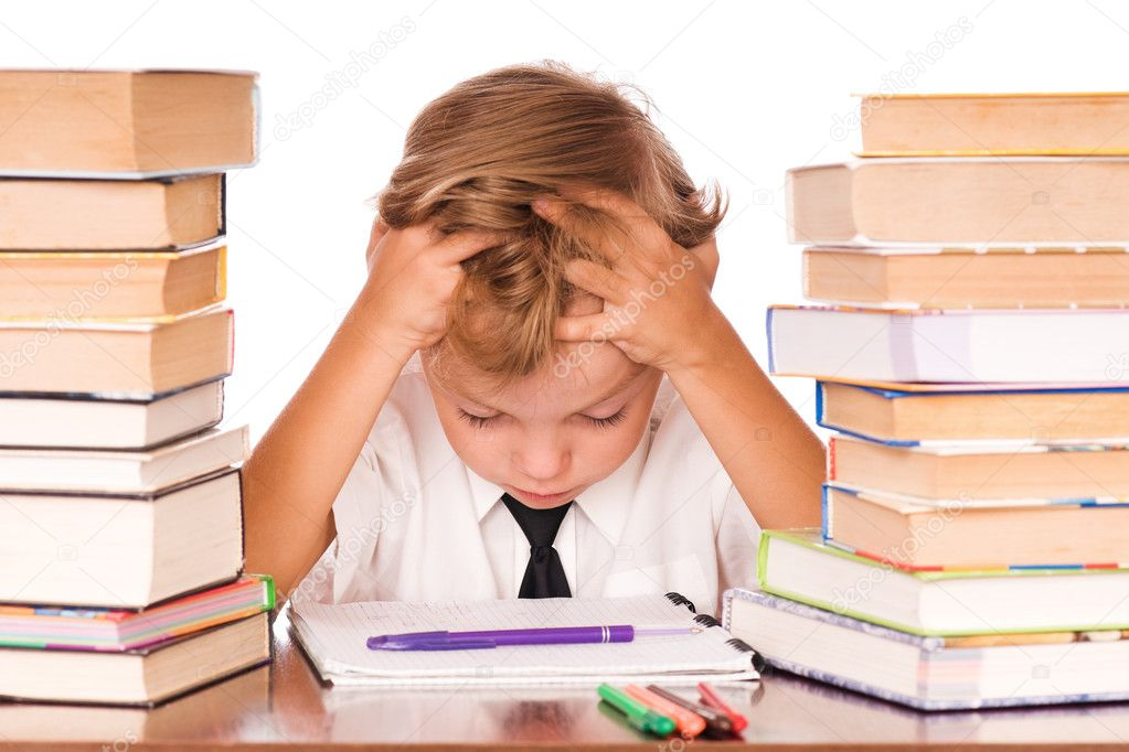 Portrait of a cute little boy sitting in library before books. Isolated over white background. — Stock Photo #3693819